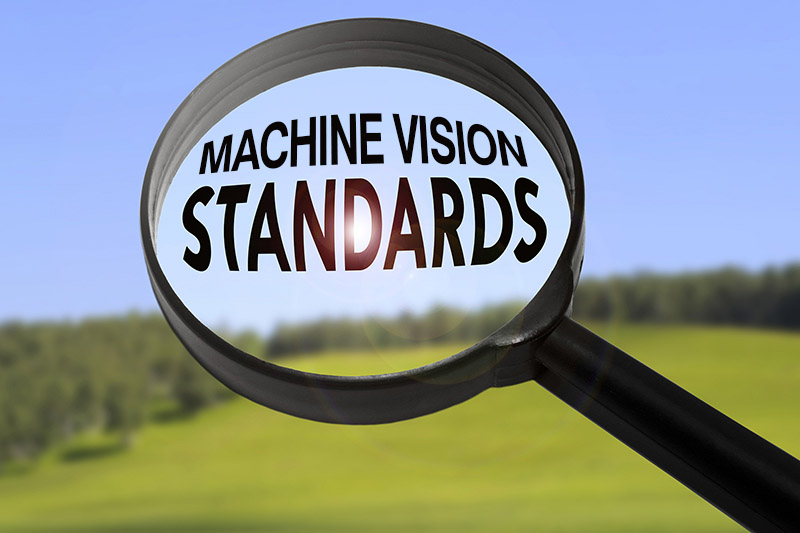 "The words ""machine vision standards"" under a magnifying glass"