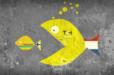 Small fish with FocalSpec logo is being swallowed by larger fish with TKH logo representing the acquisition of the smaller company