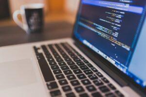 Laptop displaying software code