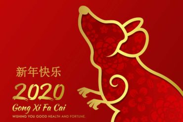 Read image with a gold rat and New Year greeting in simplified chinese
