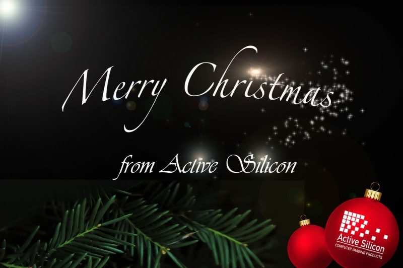 Merry Christmas message with festive baubles