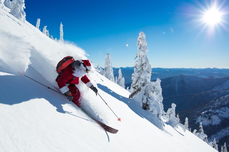 Santa skiing in winter landscape