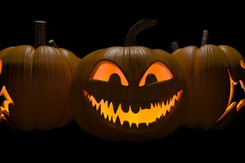 Rotating carved Halloween pumpkins