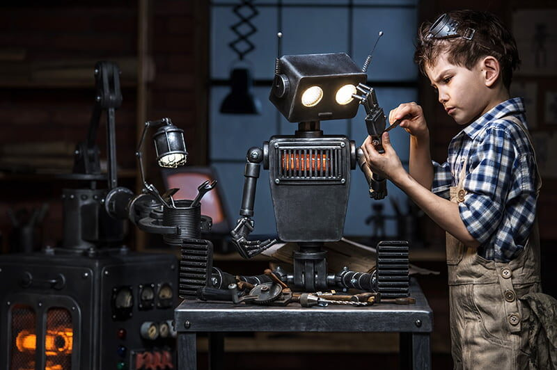 Child engineer working on a robot