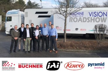 Machine vision experts standing in front of the Machine Vision Roadshow truck