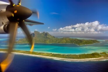 Plane propeller flying over an atoll