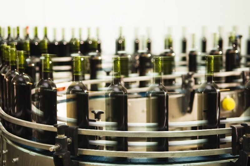 Fast-moving bottles on a production line