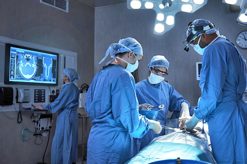 Surgeons in the operating theatre consulting computer images