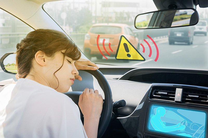 Affective computing in cars - system alarms a lady nodding off whilst driving