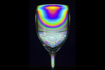Image shows a polarised image of a glass