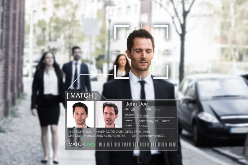 man walking in the street with digital overlay of his identity