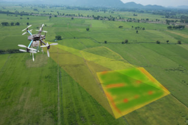 Drone projecting multispectral image onto agricultural land.