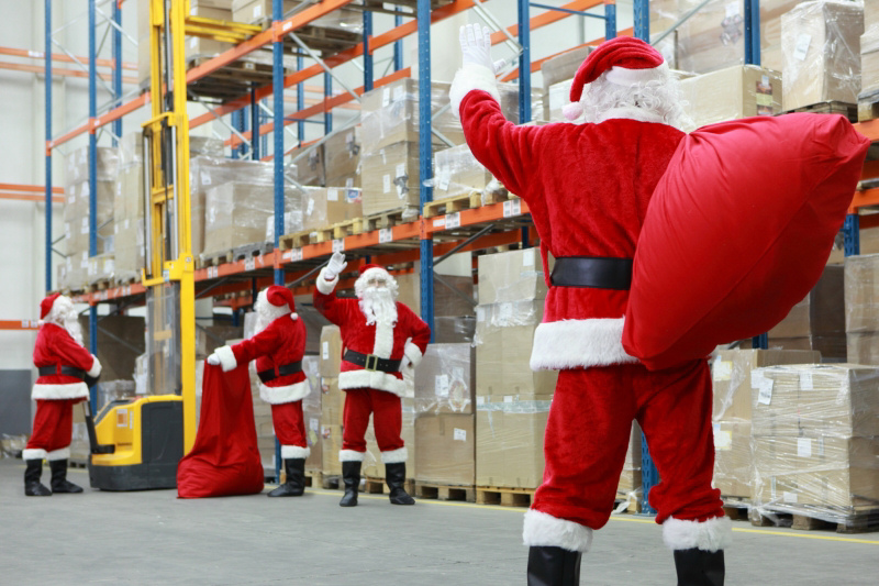 Santas working in a warehouse