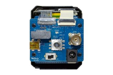 The evaluation board mounted on a Harrier 18x AF-Zoom HDMI 4K Camera